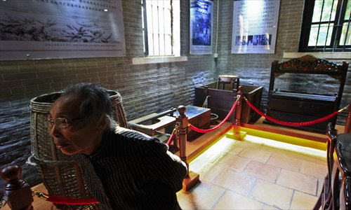 A zishunü walks past displays in Bingyutang Museum in Shunde, which houses over 100 objects from the lives of zishunü. Photo: CFP