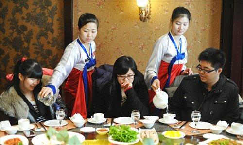 North Korean waitresses serve at a restaurant in Changchun, Jilin Province on December 5, 2012. Photo: CFP