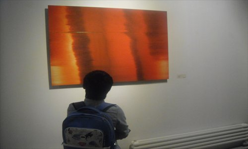 A visitor admires Bei Dao's photograph Hue. Photo: Zhang Zihan/GT