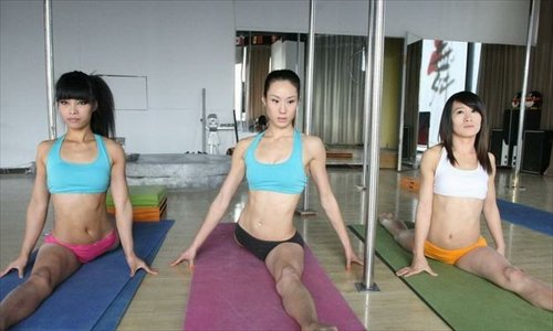 Three female Chinese national pole dancing team members, who will compete in the World Pole Dance Championships to be held in Zurich, Switzerland on November 10 training on Tuesday. This is the first open training session since the Chinese national pole dancing team was set up in Tianjin. The team consists of five women and two men on the main squad, along with six substitutes.