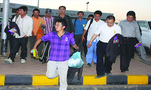 Fourteen Chinese workers taken hostage by Sudanese rebels are released in Khartoum, Sudan, on January 30, 2012. The remaining 15 hostages were later freed by Sudanese troops.  Photo: CFP