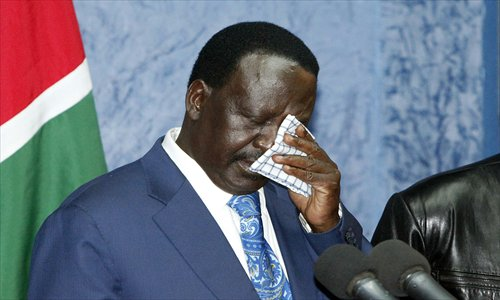 Raila Odinga, outgoing Kenyan prime minister, wipes his eyes as he addresses the media at a press conference at his office in Nairobi on Saturday. Photo: AFP