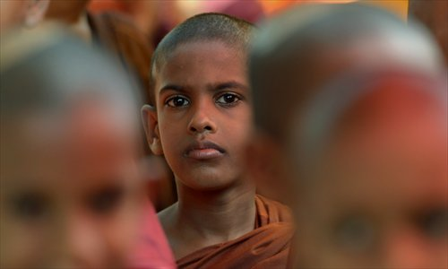A Sri Lankan Buddhist monk attends a protest outside the Indian High Commission in Colombo on Wednesday. The demonstration was against attacks on Sri Lankans visiting the south Indian state of Tamil Nadu. Sri Lankan authorities have warned tour operators against sending pilgrims to Tamil Nadu following a spate of racial attacks. Photo: AFP