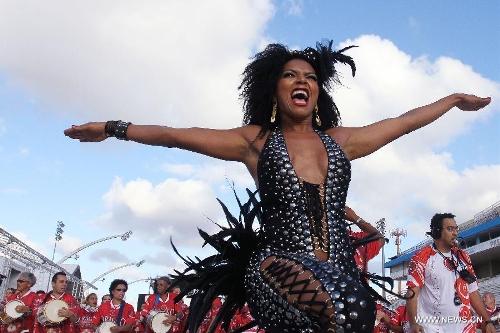 Members of samba schools participate in a rehearsal of Rio de Janeiro Carnival 2013, at the Anhembi Sambodrome, in Sao Paulo, Brazil, on Jan. 20, 2013. (Xinhua/Rahel Patrasso)