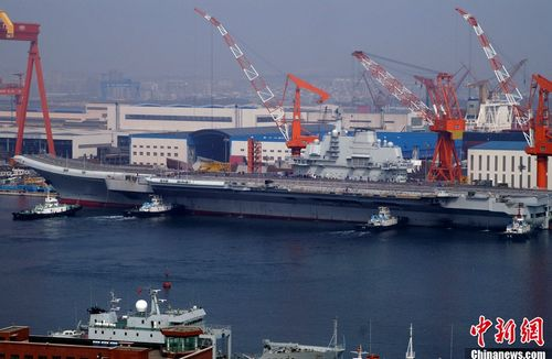 China's first aircraft carrier is refitted at the port of Dalian. The carrier, built on former Ukrainian vessel Varyag, is capable of carrying around 30 fixed wing fighters and helicopters and a crew of about 2,000. And the hull number,