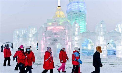 Tourists walk around at the 29th Harbin International Ice and Snow Festival in Harbin, capital of northeast China's Heilongjiang Province, December 23, 2012. The festival kicked off at the Harbin Ice and Snow World on Sunday. Photo: Xinhua