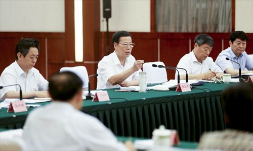 Chinese Vice Premier Zhang Gaoli (3rd R.) presides over an economic conference in Chengdu, capital of southwest China's Sichuan Province, July 6, 2013. Zhang made a research tour in Sichuan from July 5 to July 8.  Photo: Xinhua