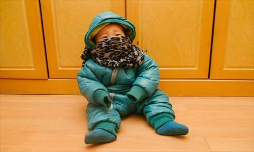 Baby With Fever Warm Clothes