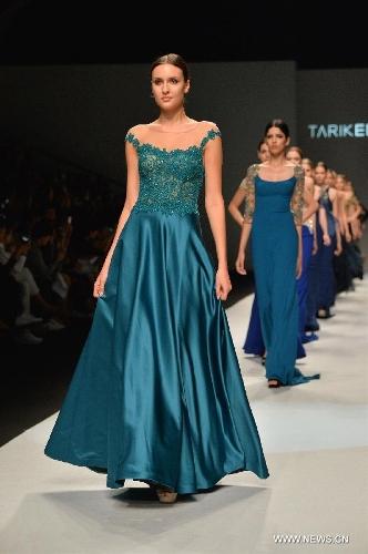 Models present wedding dress creations at Shanghai Fashion Week ...