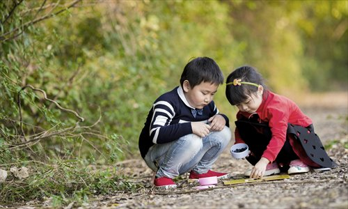 Having two children, a boy and a girl, means a perfect, completed family in Chinese culture. Photo: IC