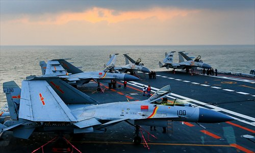 J-15 fighter planes sit on the deck of the Liaoning aircraft carrier during training exercises in the Bohai Sea on December 24, 2015. Photo: CFP