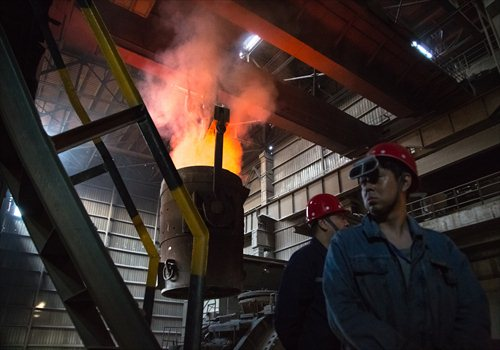 Employees work at a steel factory in Wu'an, North China's Hebei Province. Photo: CFP