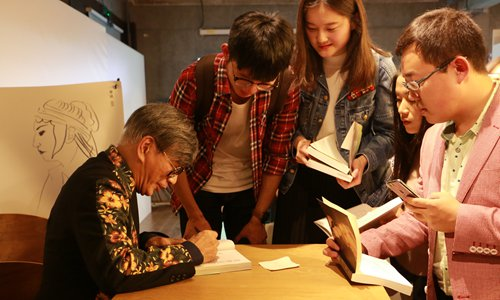 Alan Chow (left) attends a book signing in Beijing on October 15. Photo: Courtesy of Beijing Tiehulu Books