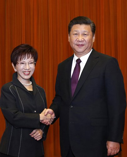 Xi Jinping (right), general secretary of the Communist Party of China Central Committee, shakes hands with visiting Kuomintang Chairperson Hung Hsiu-chu before their meeting at the Great Hall of the People in Beijing on Tuesday. Photo: Xinhua