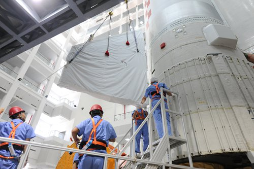 Workers install the component of the Long March-5. Photo: Sun Hao/China Academy of Launch Vehicle Technology