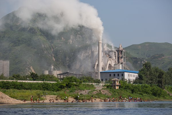 A North Korean cement factory and children washing clothes and bathing in the Yalu River are seen from Linjiang city in Northeast China's Jilin Province. Photo: Han Jiwei
