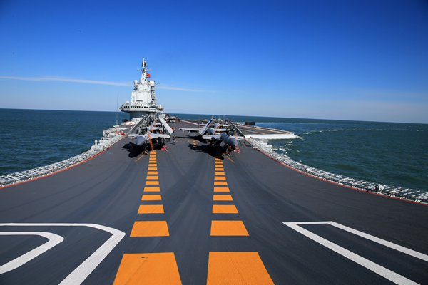 Fighter planes sit on the deck of the Liaoning aircraft carrier. Photo: Zhang Kai
