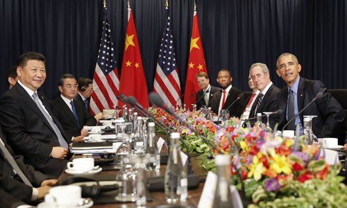 Chinese President Xi Jinping (left) with US President Barack Obama (right) and members of their delegations, during their meeting as part of the Asia-Pacific Economic Cooperation (APEC) in Lima, Peru on Saturday. Obama wants to reassure leaders from around the world that US democracy isn't broken and that everything will be fine when Republican Donald Trump succeeds him next year. Photo: AP