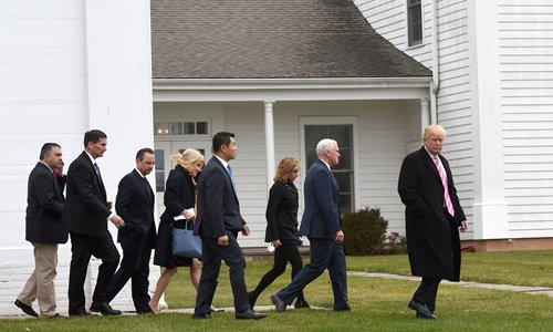 US President-elect Donald Trump (right) and Vice President-elect Mike Pence (second from right) leave the Lamington Presbyterian Church after Sunday services in Bedminster, New Jersey. Photo: AFP