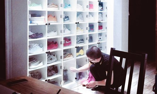 Allen Li's husband puts a pair of shoes back into their place in his super big shoe closet.  Photo: Courtesy of Allen Li