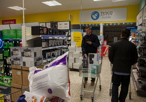 Customers shop at a Tesco store in Bristol, the UK, on November 25. Photo: CFP