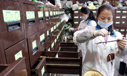 Pharmacists dispense traditional Chinese medicine (TCM) at a TCM pharmacy in Suzhou, East China's Jiangsu Province on January 6. Photo: CFP