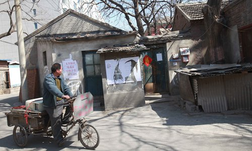 A man rides his tricycle past the old residence of Lu Xun, a writer and revolutionary during the Republic of China era, in central Beijing. Photo: CFP