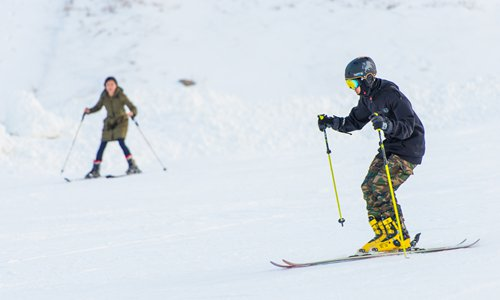 A skier speeds down a slope at a ski resort in Zhangjiakou's Chongli district in November. The Hebei Province district is to host most of the skiing events during the 2022 Winter Olympic Games. Photo: CFP