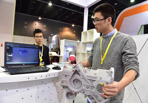 Employees demonstrate 3D technology at an exhibition in Yiwu, East China's Zhejiang Province, in November. Photo: CFP