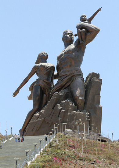 Tourists visit <em>African Renaissance</em>, a monument built by North Korea's Mansudae Art Studio, in  Senegal's capital of Dakar in May 2011. Photo: IC