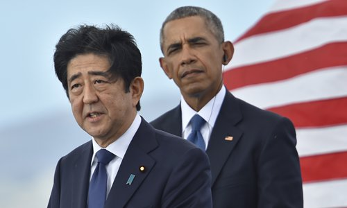 US President Barack Obama (right) listens as Japanese Prime Minister Shinzo Abe speaks at the USS Arizona Memorial on Tuesday at Pearl Harbor in Honolulu, Hawaii. Photo: AFP