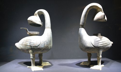 A pair of antique lanterns, each featuring a goose holding a fish in its mouth, are on display at the Jiangxi Provincial Museum in Nanchang.
