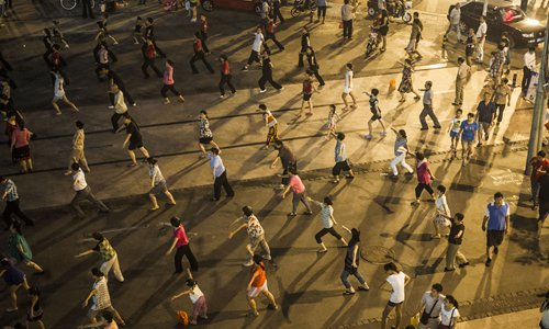 People dance in the streets when there aren't squares available. Photo: Li Hao/GT