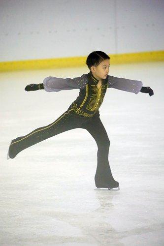 Seven-year-old boy Fubao ice skating  Photo: Courtesy of Zhou Nan