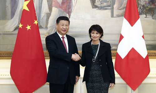 Chinese President Xi Jinping (left) and Swiss Federal President Doris Leuthard pose for photographers prior to their official talks on Monday in Bern. President Xi Jinping began a state visit to Switzerland before heading to Davos to address the World Economic Forum. Photo: AFP