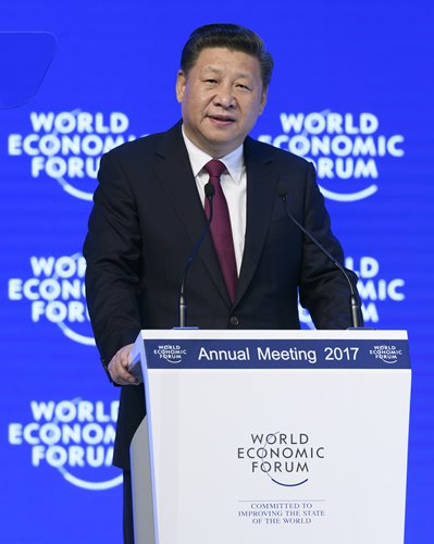 Chinese President Xi Jinping delivers a speech on the first day of the 47th annual meeting of the World Economic Forum, in the Swiss ski resort of Davos on Tuesday. President Xi said there is