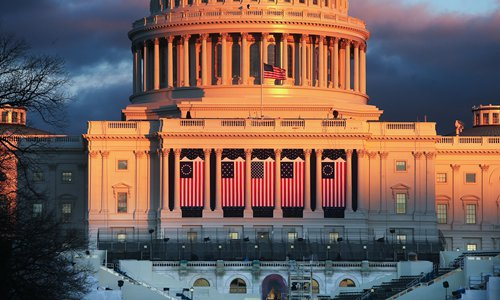 The sun sets on the West Front of the US Capitol building ahead of inauguration ceremonies for President-elect Donald Trump on Wednesday in Washington, DC. Trump will be sworn in as the 45th US president Friday. Photo: AFP