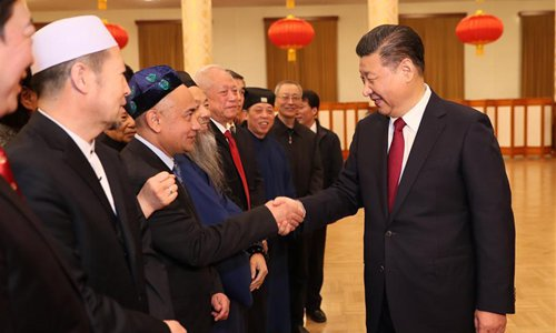 Chinese President Xi Jinping (R) shakes hands with members of the public at a reception in Beijing, capital of China, to extend Spring Festival greetings to all Chinese, Jan. 26, 2017. This year's Spring Festival, or Chinese Lunar New Year, falls on Jan. 28. (Xinhua/Ju Peng)