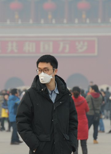 A visitor to Tiananmen Square in Beijing wears a face mask on the first day of the Lunar New Year. Photo: CFP