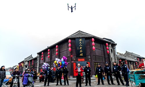Police operate a drone to monitor illegal fireworks in Huaxian county, Henan Province. Photo: CFP