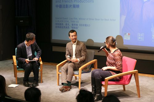 Promotional material for <em>People Run from Cars</em> Photo: ICInset: Actor Liao Fan (center) attends the opening of Eyes on Berlin at the French Institute of China on Friday. Photo: Courtesy of Goethe-Institute China