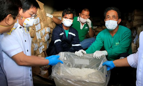 Philippine Drug Enforcement Agency (PDEA) agents display confiscated illegal drugs before destroying them through thermal decomposition in Trece Martires, Cavite, the Philippines on Thursday. The drugs were worth $9.5 million. Photo: CFP