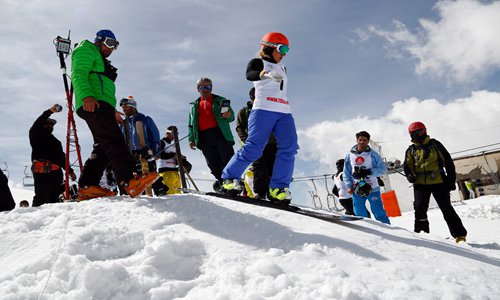 A young Iranian girl is in action during the last FIS snowboard competition in Iran, at the Tochal ski resort near Tehran, in May 2016. Photo: IC