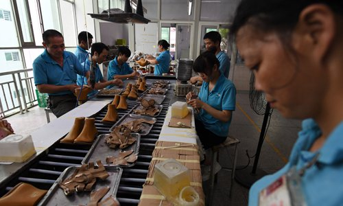 Workers are on a production line at the Huajian shoe factory, where about 100,000 pairs of Ivanka Trump-branded shoes have been made over the years amongst other brands, in Dongguan, South China's Guangdong Province. Photo: AFP