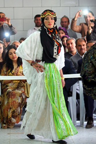 Syria's Kurds hit catwalk to promote traditional attire ...