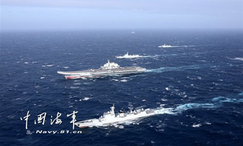A naval formation consisting of aircraft carrier <em>Liaoning</em> has conducted take-off and landing drills in the South China Sea on Jan. 1, 2017. The formation, which is on a cross-sea area training exercise, involved J-15 fighter jets, as well as several ship-borne helicopters. Photo: Navy.81.cn