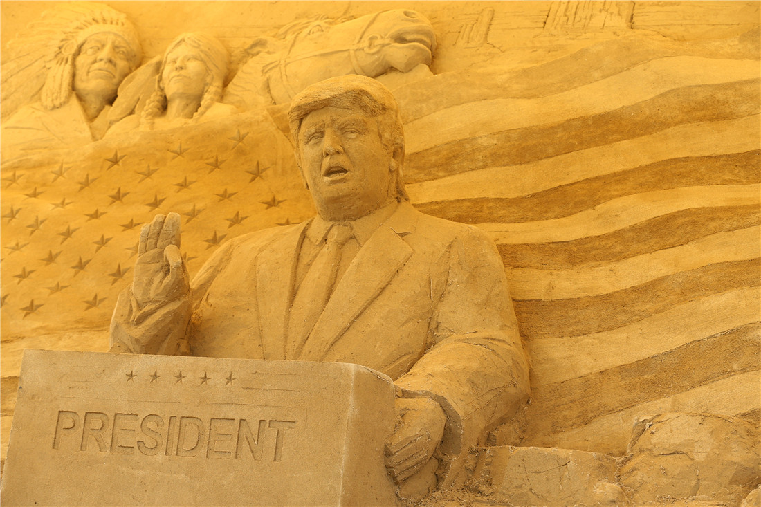 sand sculpture of donald trump on display in japan
