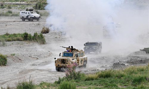 Armored vehicles move during a joint anti-terrorist exercise held by China and Kyrgyzstan frontier forces in Kizilsu Kirgiz Prefecture, northwest China's Xinjiang Uygur Autonomous Region, June 27, 2017. The drill, carried out under the framework of the Shanghai Cooperation Organization (SCO), was witnessed by representatives from Kazakhstan, China, Kyrgyzstan, Russia, Tajikistan and Uzbekistan, all the SCO member countries. (Xinhua/Wang Fei)
