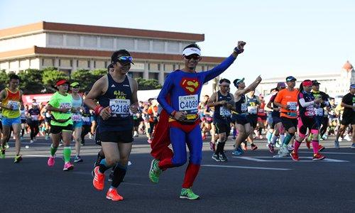 A man dressed as Superman runs in the 2017 Beijing Marathon. Photo: VCG