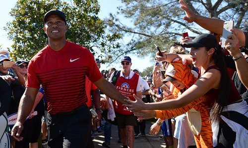 Woods 'very pleased' after Tour return